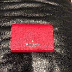 Red Kate Spade Wallet - never been used.
